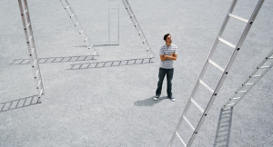 Man standing outdoors with arms crossed with ladders. Image shot 2007. Exact date unknown.